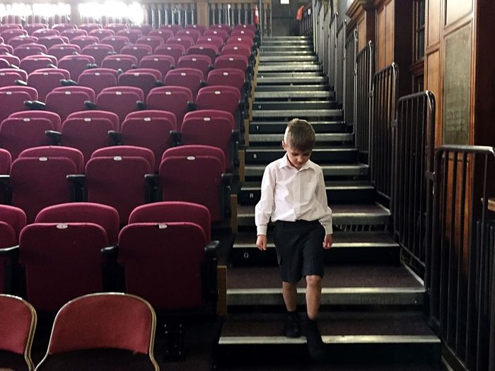 Boy Moving Down On Steps In Stage Theater