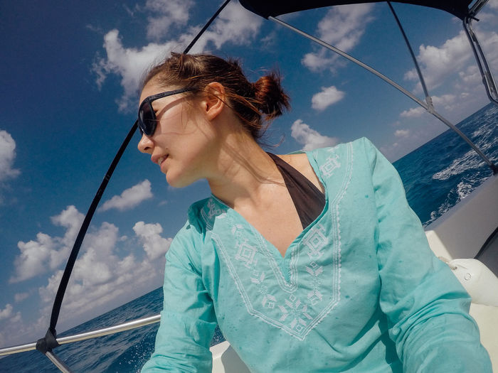 Beautiful Woman Cloud - Sky Day Leisure Activity Lifestyles Mode Of Transport Nature Nautical Vessel One Person Outdoors Real People Sea Sky Transportation Water Young Adult Young Women