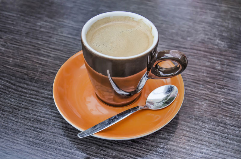 Drink Refreshment Food And Drink Cup Table Coffee Saucer Crockery Mug Spoon Coffee Cup Eating Utensil Coffee - Drink Still Life Kitchen Utensil Freshness Indoors  Food High Angle View Wood - Material No People Hot Drink Non-alcoholic Beverage Tea Cup Teaspoon