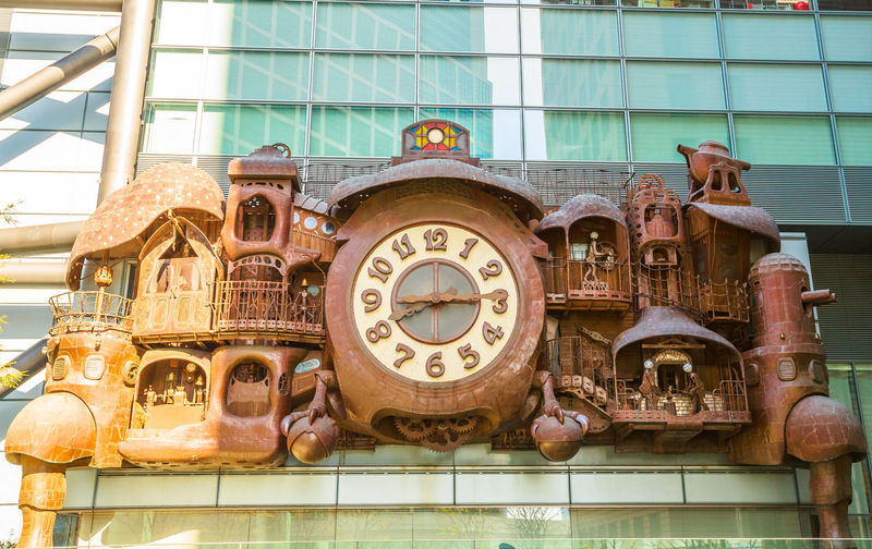 Tokyo, Japan : Ghibli clock in front of Nittele Tower, Nippon Television headquarters, Minato ward. The victorian steampunk clock icon of Shimbashi District. Giant Ghibli clock on facade of Nittele Tower or headquarters of Nippon Television in Shiodome area, Minato.It was designed by Hayao Miyazaki co-founder of Studio Ghibli Ghibli Ghibli Museum Ghibli Clock Japan Minato Ward Nippon Television Nittele Nittele Tower Steam Tokyo Tokyo, Japan Tokyo,Japan Architecture Building Building Exterior Built Structure City Clock Clock Tower Day Equipment Headquarters Hq Industry Low Angle View Machinery Minatomirai Nature Nippon No People Outdoors Shape Shimbashi Shimbashi Station Steampunk Technology Time Travel Travel Destinations Tv Victorian Architecture Victorian Style Window
