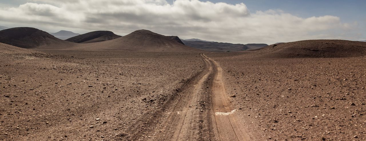 Four Wheel Drive Track in Damaraland, a Region of Namibia 4wd 4wd Road 4wd Track Damaraland Desolate Holidays Namibia Travel Arid Climate Desert Environment Landscape Mountain Range Nature Road Scenics - Nature Southern Africa Vacation