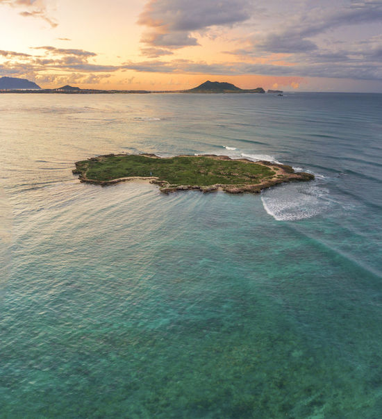 A tiny island near Lanikai Beach Beautiful Nature Hawaii Lanikai Beach Sunset_collection Tranquility Waikiki Aloha Beauty In Nature Bird Sanctuary Clouds And Sky Holiday Destination No People Outdoors Paradise Sunset Tiny Island Travel Destinations
