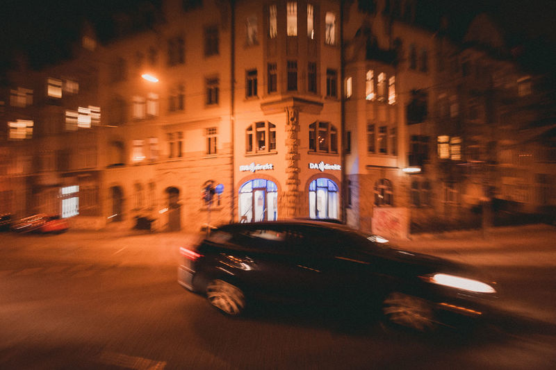 Blurred Motion Motion Mode Of Transportation Transportation Building Exterior Night Architecture City Built Structure Car Motor Vehicle Illuminated Street Land Vehicle Speed Road on the move Long Exposure Building No People
