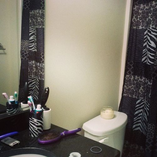 Ourbathroom Lookinglike Mybathroom can't even tell he lives here lol. Zebra cheetah blackandwhite modern there is twotoothbrushes