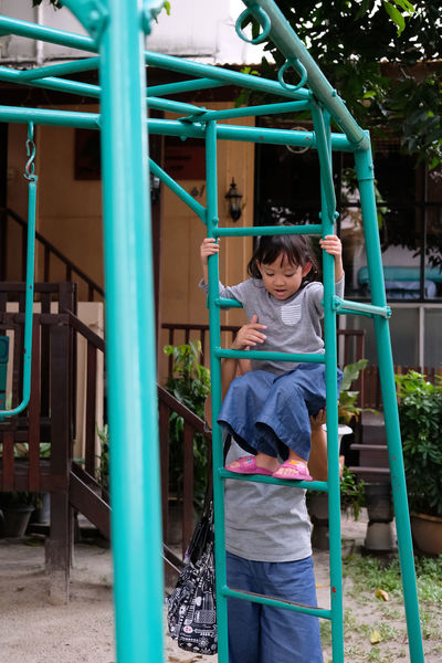 asian girl try to climb up playground climbers with mom Climb Up! Playground Equipment Casual Clothing Childhood Day Front View Girls Happiness Holding Leisure Activity Lifestyles Outdoor Play Equipment Outdoors Playground Playground Blimbers Playground Climbing Playgrounds Playing Real People