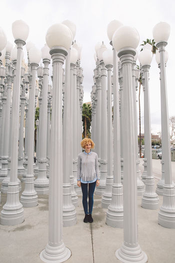 Architecture California City Los Angeles, California Tourist Attraction  Architectural Column Architecture Building Exterior Built Structure Curly Hair Day Full Length Girl History La One Person Outdoors Pillar Real People Sky Standing Tourist Destination Travel Destinations Young Adult Young Women Been There. Connected By Travel California Dreamin