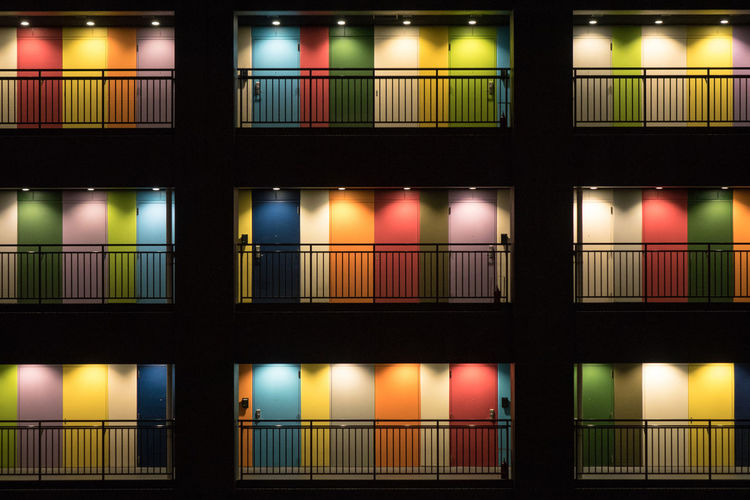 Full frame shot of illuminated lights on window at night