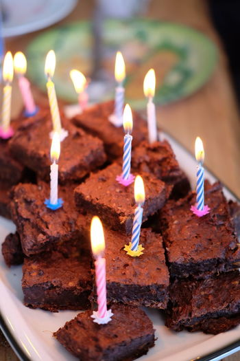 Close-Up-Up Of Lit Candles On Birthday Cakes
