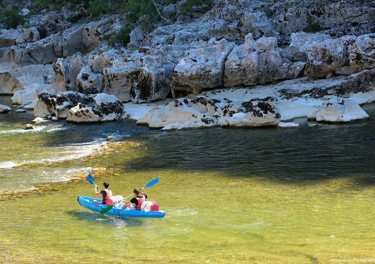 Two people canoeing in the ardeche river
