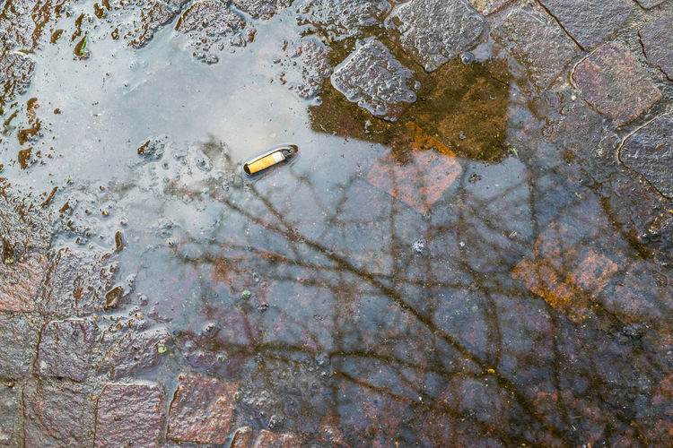 Urban Urban Life No People City City Life Cigarette  Cıgarettes Reflection Reflections Dirt Dirty Dirty Water  Incivility Rudeness Puddle Standing Water Water Pollution Pollution Sewage Garbage Dump Air Pollution Smoke Stack