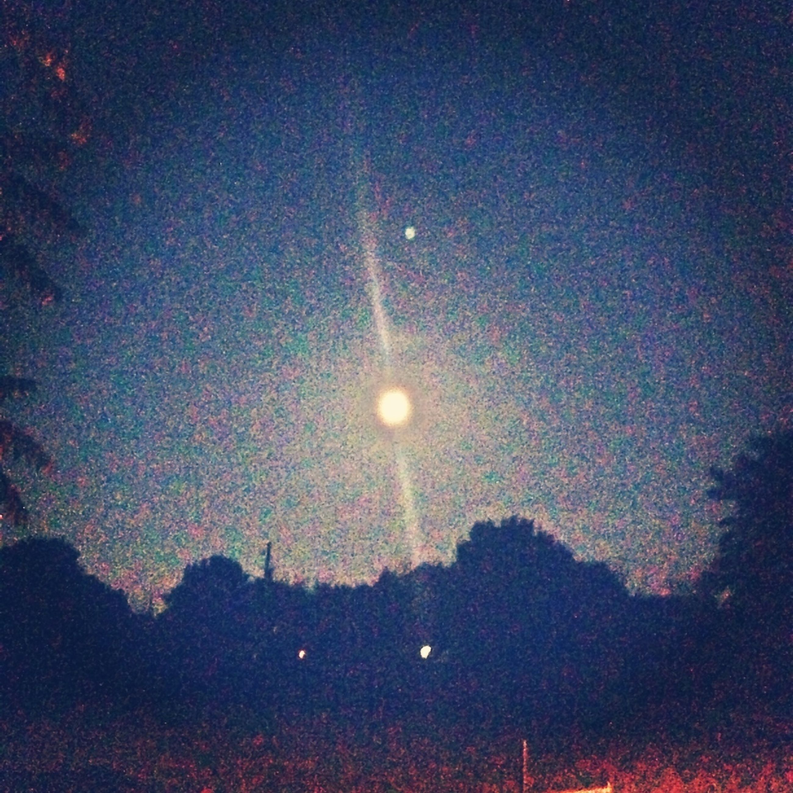 night, moon, illuminated, sky, low angle view, astronomy, scenics, tranquility, beauty in nature, full moon, dark, tranquil scene, nature, silhouette, street light, star - space, idyllic, lighting equipment, glowing, tree