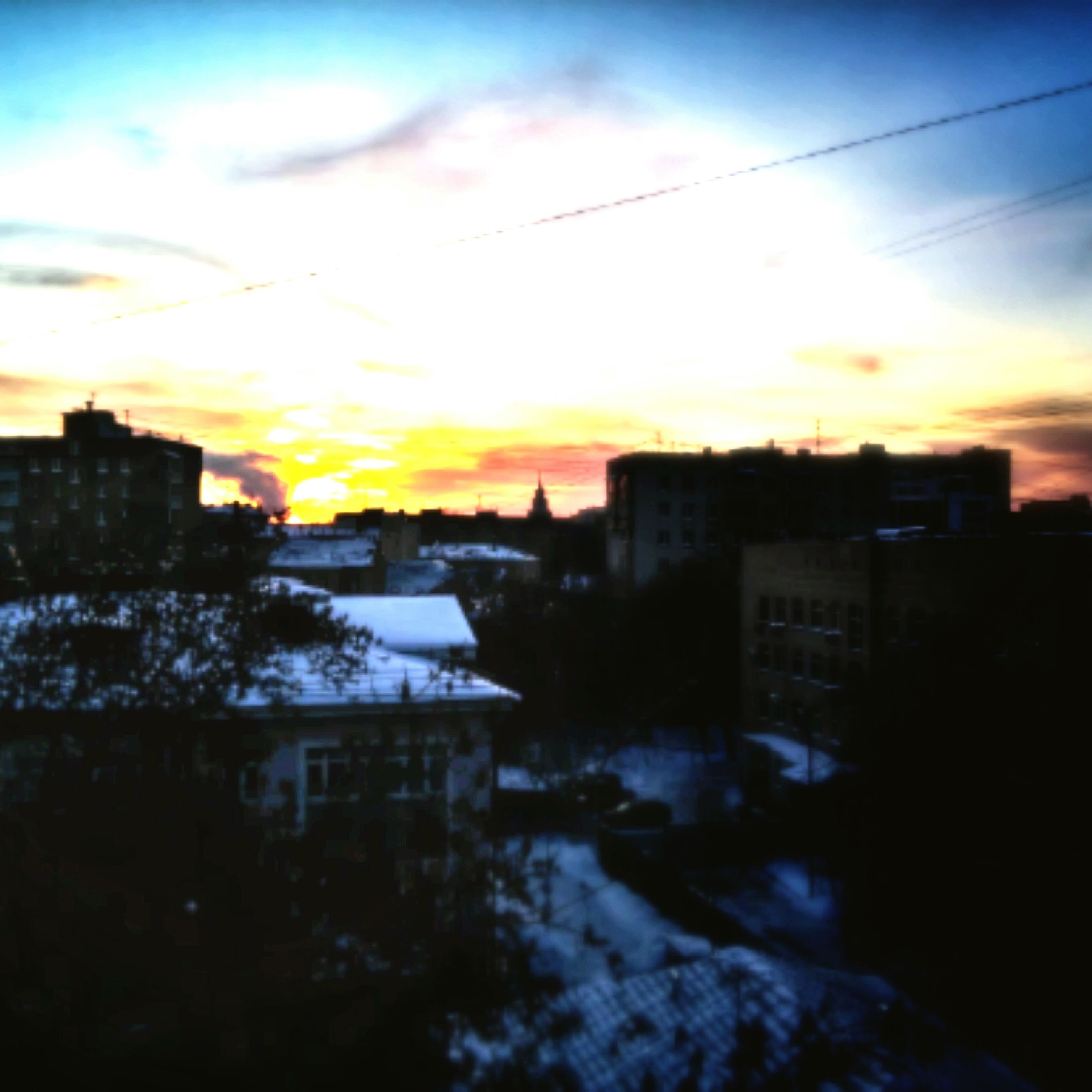 sunset, building exterior, architecture, built structure, sky, cold temperature, city, snow, winter, season, residential structure, residential building, cloud - sky, house, weather, orange color, residential district, water, cityscape, sun