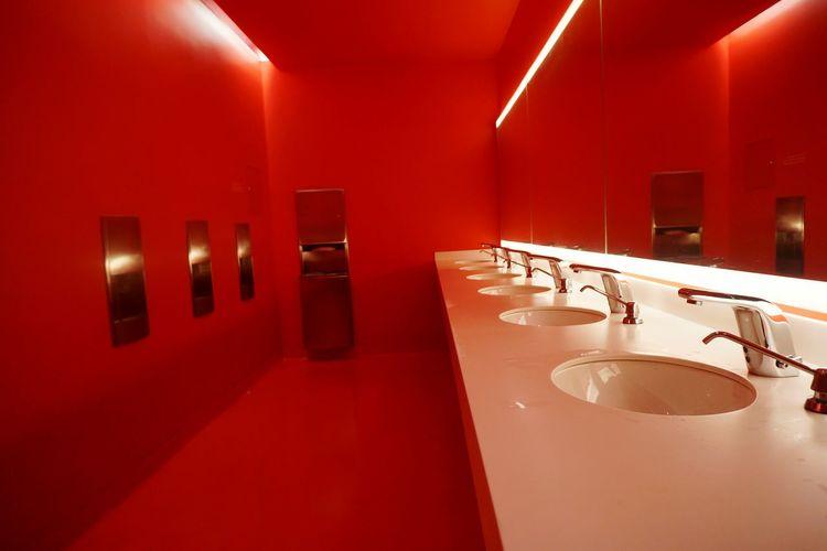 Interior of red public restroom