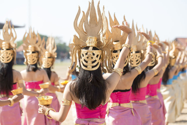 Rear View Of Women Wearing Costumes Dancing At Event
