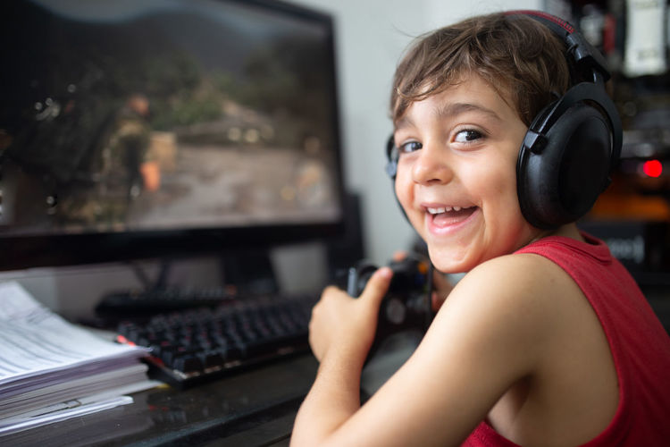 Portrait of boy playing with video game