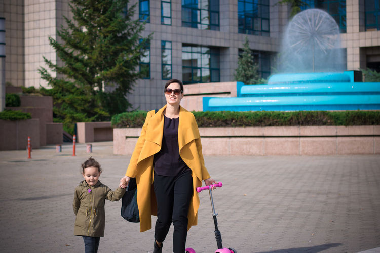 City Family Happiness Holding Hands Mother Woman Adult Bonding Caucasian Child Childhood City Daughter Female Females Guidance Kid Mid Adult Offspring Parent Smiling Togetherness Two People Walking Women