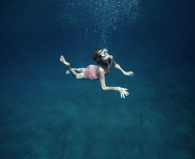 Done That. Illuminated Water Underwater Swimming UnderSea Full Length Sea One Person Real People Young Women Young Adult Animal Themes Beauty In Nature Sea Life Nature Animals In The Wild Day Outdoors Mammal People Connected By Travel Lost In The Landscape EyeEm Ready