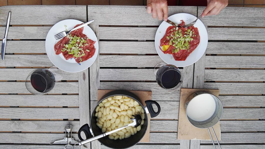 Bowl Breakfast Carpaccio Chopsticks Dinner Directly Above Eating Food Freshness Friends Gnocchi Indulgence Lunch Meal Overhead View Ready-to-eat Refreshment Served Serving Size Still Life Table Togetherness Wood Wood - Material Wooden