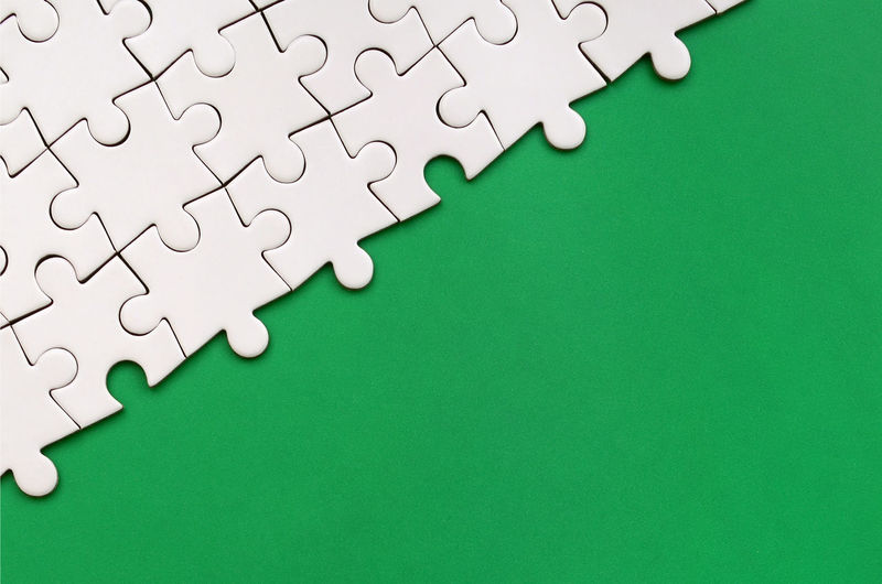 Jigsaw Piece Jigsaw Puzzle Green Color Puzzle  Indoors  Copy Space Connection Solution White Color Pattern No People Backgrounds Leisure Activity Large Group Of Objects Close-up High Angle View Full Frame Blank Leisure Games Studio Shot Electrical Component