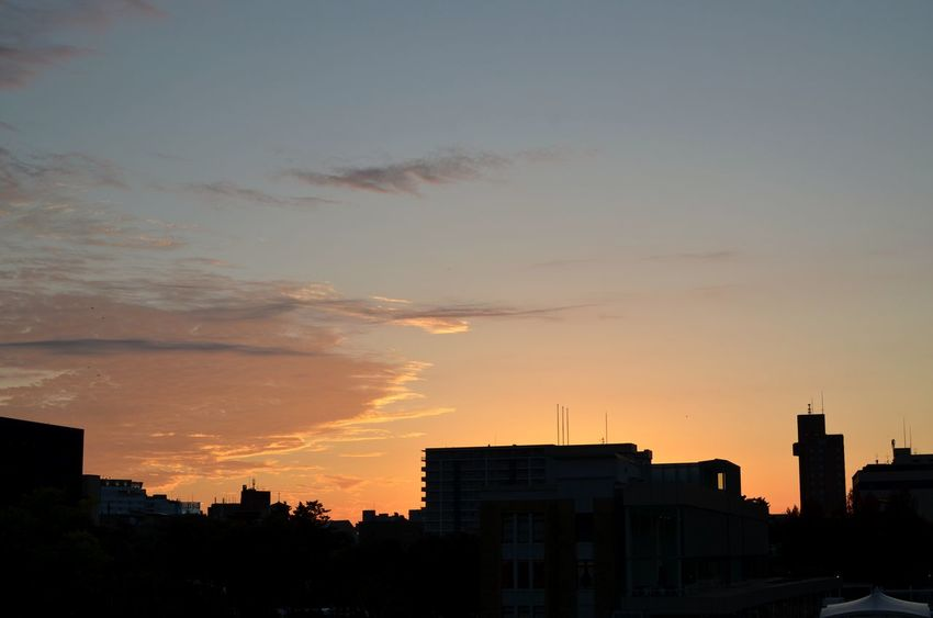 Sunset outlines the silhouettes of a small Japanese city. Architecture Building Exterior Cloud - Sky Orange Color Silhouette No People Cityscape Romantic Sky Japan Sunset Travel Destinations Skyline At Sunset  Tranquility Peace And Quiet Twilight