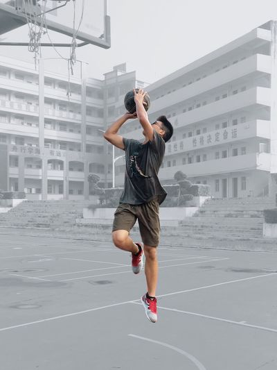 One Person Full Length Architecture City Sport Lifestyles Men Jumping Motion Outdoors Inner Power