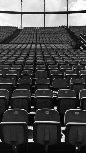 Seating Blackandwhite Seat In A Row Chair Empty Side By Side Repetition Large Group Of Objects Arrangement Order No People Stadium Day