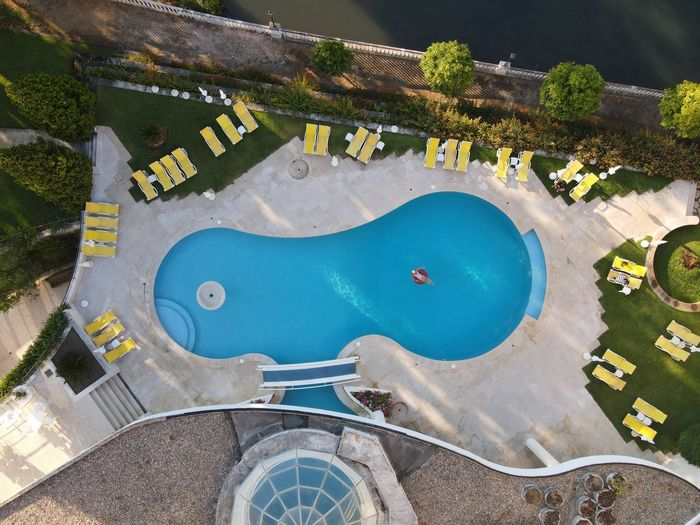 High angle view of swimming pool in city