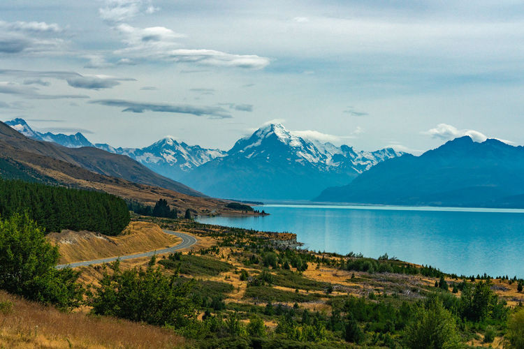 Scenic view of snowcapped mountains against sky in new zealand
