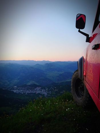 Transportation No People Land Vehicle Landscape Red Outdoors Nature Mountain Day Sky Clear Sky Mountain Range Hills And Valleys Hill Defender90 Landroverlove Defender_life_style Landrover Defender Sunset Fir Tree Tree Area My City EyeEmNewHere