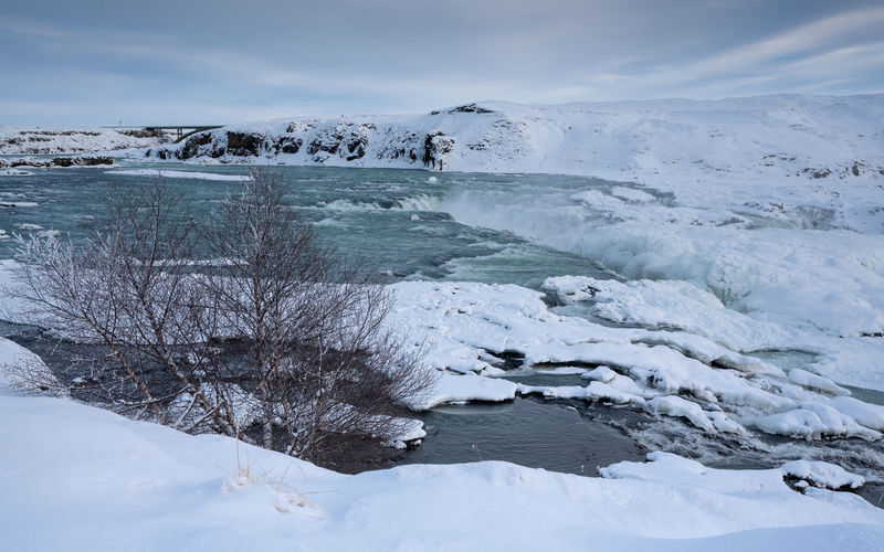 Panoramic image of the frozen waterfall urridafoss, iceland, europe