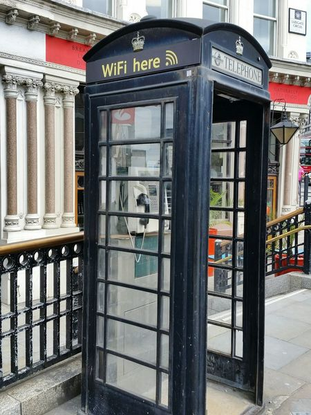 Times Change Past And Future Past And Present Telephone Booth Telephone Communication No People Day Old-fashioned Built Structure Architecture Outdoors Pay Phone Building Exterior Wifi WIFI Zone Internet Addiction EyeEm LOST IN London Stories From The City