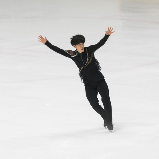 Kim Jinseo, A Korean Male Figure Skater Asian  Athlete Figure Skating Ice Arena Ice Rink Ice-skating Korean Winter Sport Awesome Energetic Figure Skater Free Skating Full Length Ice Skate Indoors  Korean Man One Person Portrait Real People Skate Skating Skillful White Background Young Adult Young Man