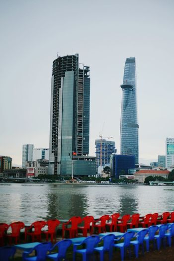 TakeoverContrast Architecture Building Exterior Built Structure Water City Mid Distance Tall - High Clear Sky Day Sky Outdoors Waterfront Financial District  Landscape Bitexcotower Sai Gon City Hcmcity Sai Gon River Chairs Skyscraper Office Building