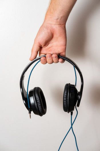Technology Cable Indoors  Connection Electric Plug Music Holding Studio Shot White Background Listening Hand Audio Equipment