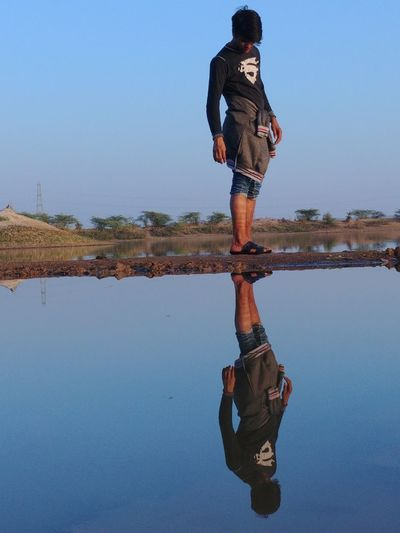 Water Water Reflections Reflection Upside Down EyeEm Selects Reflection Water Adult Adults Only One Man Only Fashion Sky Only Men Clear Sky One Person Standing Lake Full Length Day
