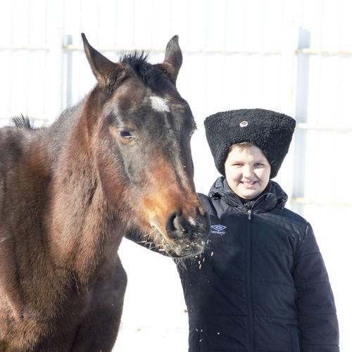 Cossacks Mammal Domestic Animals Real People Childhood One Person Pets Domestic Boys Looking At Camera Portrait Child Vertebrate Leisure Activity Males  One Animal Warm Clothing Innocence Outdoors