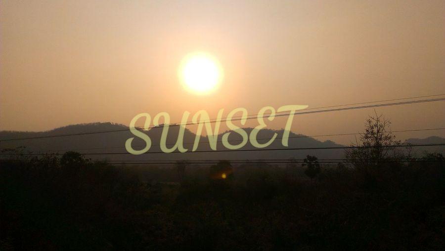 Information sign on landscape at sunset