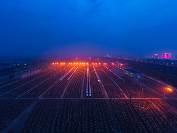 default Travel Train Train Station Outdoors No People Sky High-speed Rail City Cityscape City Lights Railway Night Nightlife Illuminated Motion Long Exposure Transportation Architecture Road High Angle View Speed Blue Traffic Mode Of Transportation Lighting Equipment Building Exterior