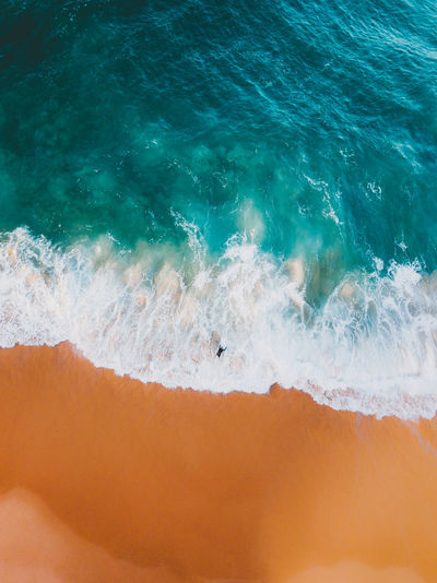 Sea Water Motion Wave Beauty In Nature Sport Scenics - Nature Surfing Aquatic Sport Land Nature Day Beach High Angle View Outdoors Power Idyllic Power In Nature Turquoise Colored Drone