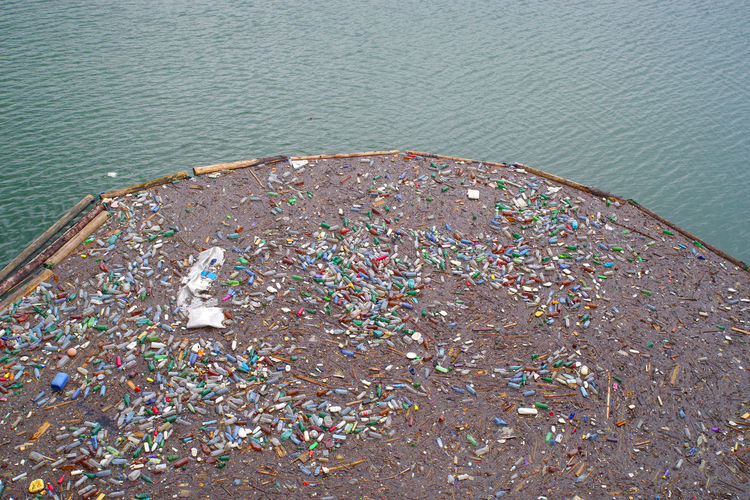 High angle view of garbage by sea