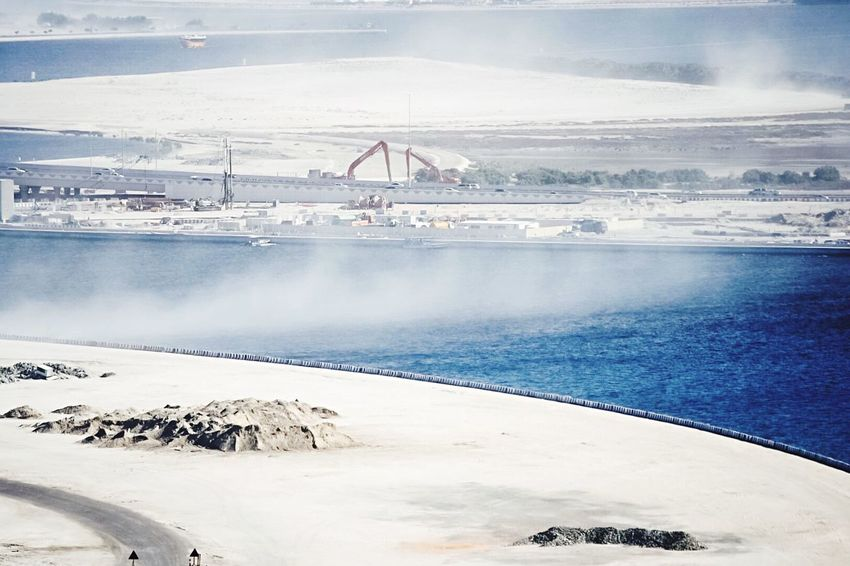Sand Wind Wind Power Built Structure Winter Sky Architecture Day Cold Temperature Travel Destinations Outdoors No People Water Nature Bridge - Man Made Structure Dubai Sandstorm Dust