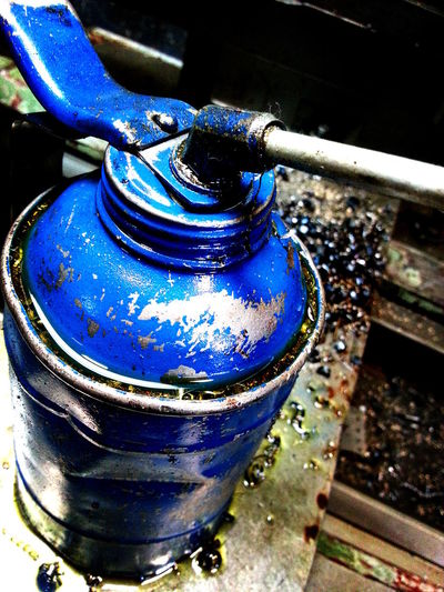 Blue Blue Collar Close-up Curve Dirty Fine Art Grease Pump Garage Messy Metal Metal Shrapnel Metallic Fragments Oil Pump Purity Service Station Showcase August 2016 Shrapnel Street Photography Strength Urban Photography Workshop Workspace Colour Palette Still Life Lines And Shapes