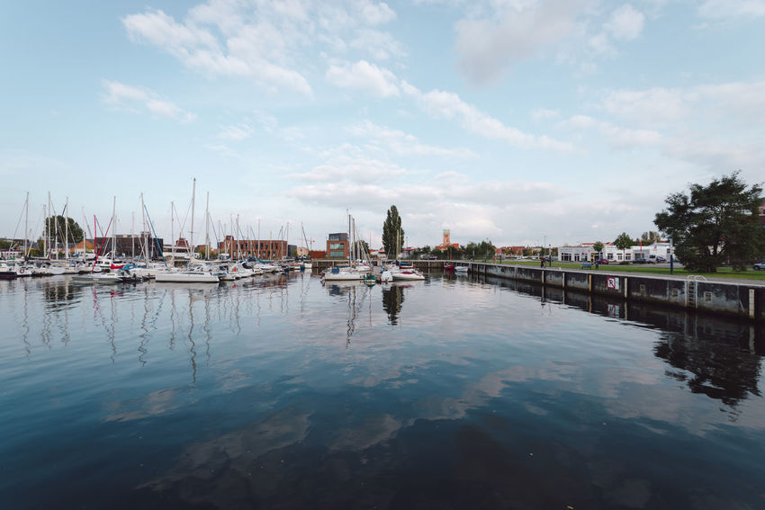 boats moored at harbor against sky Baltic Sea Mecklenburg-Vorpommern Travel Wismar Harbor Architecture Beauty In Nature Cloud - Sky Day Germany Hanseatic Harbor Mast Moored Nature Nautical Vessel No People Ocean Outdoors Reflection Sky Transportation Travel Destinations Water Wismar