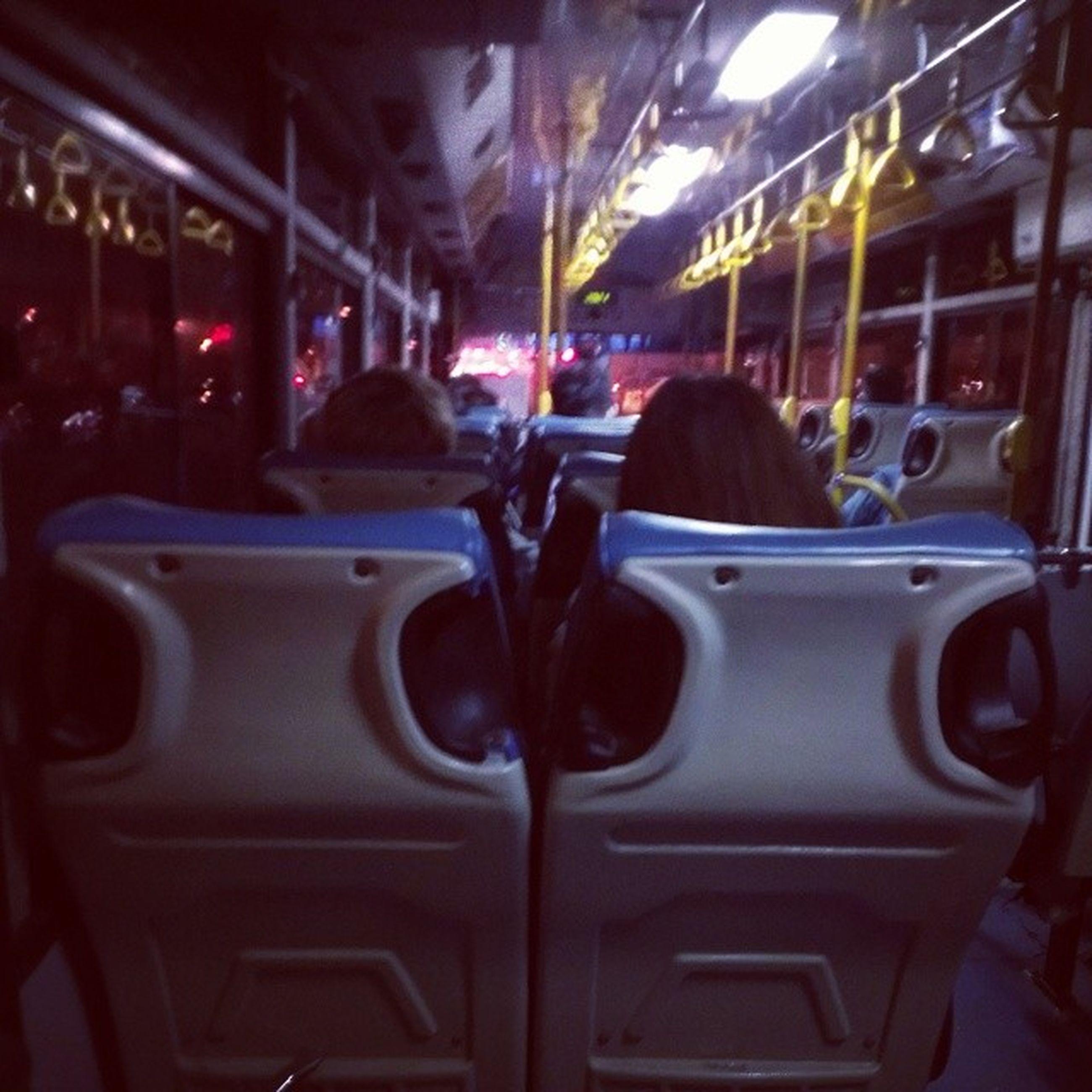 transportation, mode of transport, land vehicle, car, street, men, illuminated, bus, travel, city life, person, city, night, lifestyles, rear view, incidental people, public transportation, on the move, city street