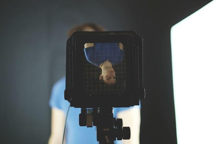 Upside Down Image Of Man On Large Format Camera