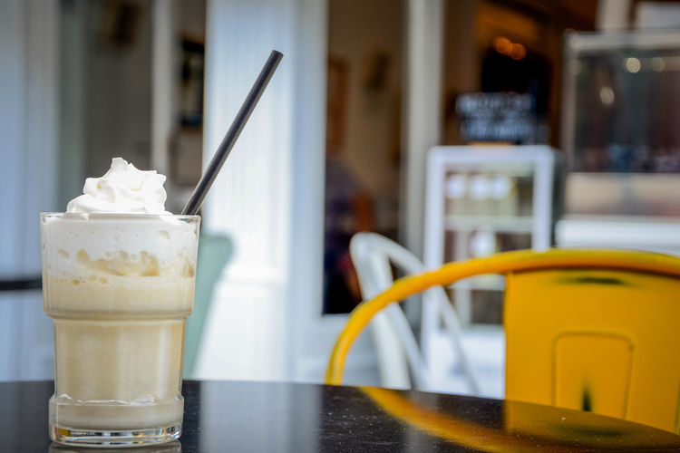Banana Shake Business Cafe Close-up Dairy Product Dessert Drink Drinking Straw Focus On Foreground Food Food And Drink Freshness Glass Household Equipment Indoors  Indulgence Latte No People Refreshment Restaurant Straw Sweet Food Table Temptation