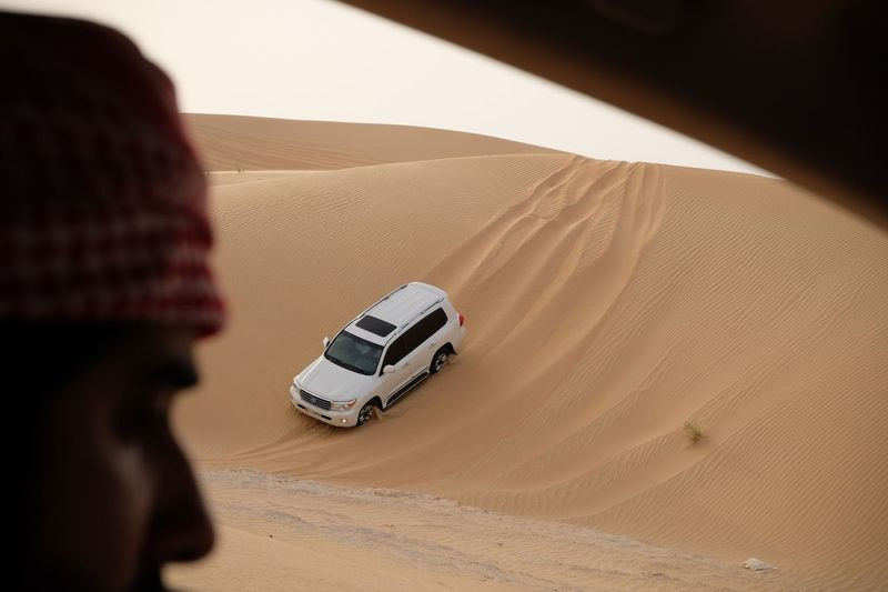 Rear view of man in desert