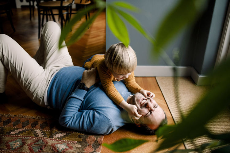 Boy lying on floor at home
