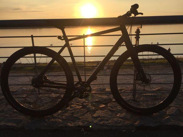 Sunset Sunset Sky Transportation Bicycle Sun Sunlight Silhouette Nature Orange Color Land Vehicle Mode Of Transportation Water Land Spoke No People Outdoors Wheel Lens Flare Stationary Beach