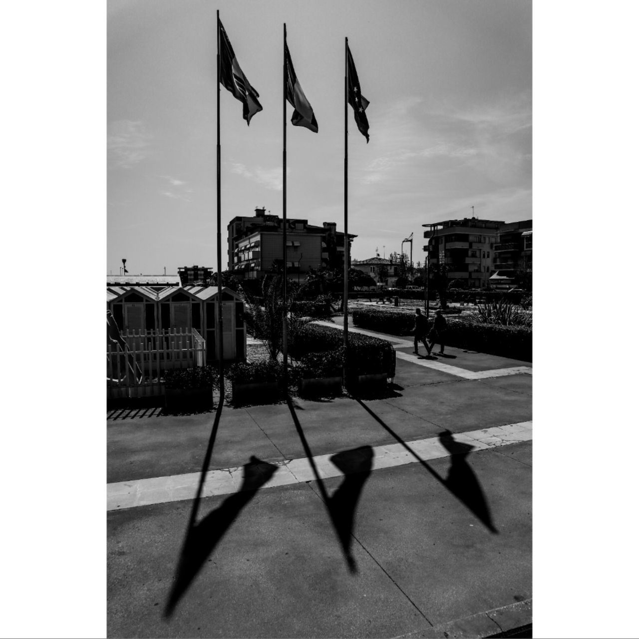 flag, building exterior, architecture, sky, nature, built structure, city, auto post production filter, sunlight, shadow, transfer print, day, patriotism, street, cloud - sky, outdoors, transportation, symbol, no people
